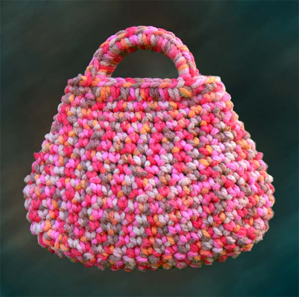 Crocheted in Sirdar Bigga Yarn , this simple but sweet bag is fun